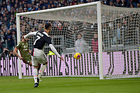 6th January 2020; Allianz Stadium, Turin, Italy; Serie A Football, Juventus versus Cagliari; Cristiano Ronaldo of Juventus beats goalkeeper Robin Olsen of Cagliari to score in the 49th minute - Editorial Use