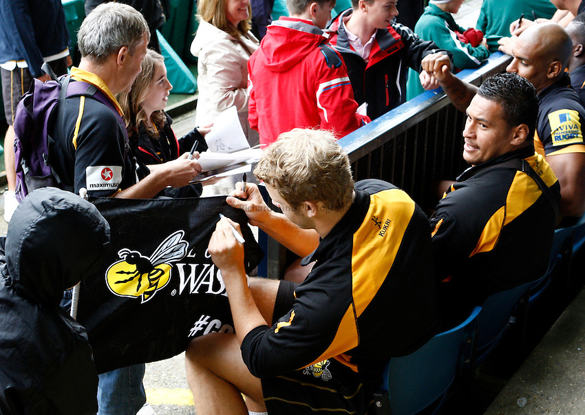 Photo: Richard Lane/Richard Lane Photography. London Wasps v London Irish. Pre Season Friendly. 24/08/2013. Stinger Day, players sign autographs for supporters.