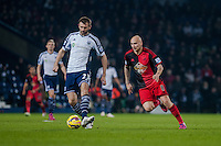 WEST BROMWICH, ENGLAND - FEBRUARY 11:   Gareth McAuley of West Bromwich Albion is chased by Jonjo Shelvey of Swansea City  during the Premier League match between West Bromwich Albion and Swansea City at The Hawthorns on February 11, 2015 in West Bromwich, England. (Photo by Athena Pictures/Getty Images)