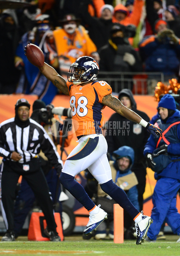 Jan 12, 2013; Denver, CO, USA; Denver Broncos wide receiver Demaryius Thomas (88) scores a touchdown against the Baltimore Ravens during the AFC divisional round playoff game at Sports Authority Field.  Mandatory Credit: Mark J. Rebilas-