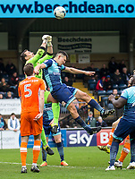 Luke O'Nien of Wycombe Wanderers challenges Goalkeeper Dean Lyness of Blackpool during the Sky Bet League 2 match between Wycombe Wanderers and Blackpool at Adams Park, High Wycombe, England on the 11th March 2017. Photo by Liam McAvoy.