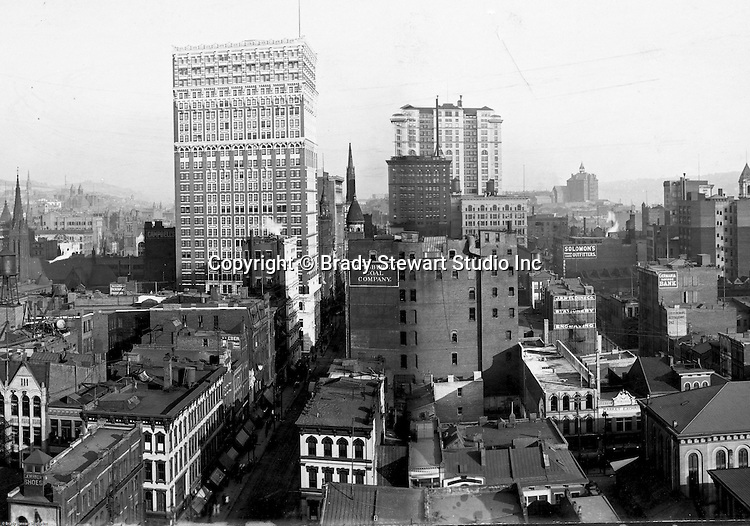 Pittsburgh PA:  View of City from the top of the Empire Building - 1904.  View of the city looking up Fifth Avenue.  Farmers Bank, Frick and Arrott Buildings dominate the skyline.  Company signs on the city buildings include: C.A. Verner Shoes, George Reineman's Restaurant, Germania Savings Bank, Home Trust Company of Pittsburgh, JR Weldin & Company Stationery, Pittsburgh Coal, and Solomon's Outfitters