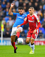 Gareth Evans of Portsmouth left tackles Stuart O'Keefe of Gillingham during Portsmouth vs Gillingham, Sky Bet EFL League 1 Football at Fratton Park on 12th October 2019