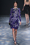 Model Blanca walks runway in a royal blue organza cocktail with silver bugles and 3D feather flower embroidery, from the Marchesa Fall 2016 collection by Georgina Chapman and Keren Craig, presented at NYFW: The Shows Fall 2016, during New York Fashion Week Fall 2016.