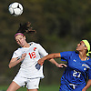 Rachel Florenz #18 of East Islip, left, heads a ball away from Nia Griffith #27 of North Babylon during a first round Suffolk County Class AA varsity girls soccer playoff game at East Islip High School on Monday, Oct. 24, 2016. Florenz found the back of the net with 7:48 remaining to break a scoreless tie and lead East Islip to a 1-0 win.