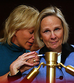 Washington, D.C. - March 24, 2004 -- Beverly Eckert of Connecticut, left, is consoled by Ann MacRae, right as Richard Clarke apologized to the families of the victims of the 9/11 attecks. at the hearing of the National Commission on Terrorist Attacks Upon the United States in Washington, DC on March 24, 2004.  Ms. Eckert lost her husband, Sean Rooney in the collapse of Tower 2 of the World Trade Center.  Ms. MacRae lost her daughter, Cat MacRae, 23, who was on the 93rd floor of Tower 1.<br /> Credit: Ron Sachs / CNP<br /> [RESTRICTION: No New York Metro or other Newspapers within a 75 mile radius of New York City]