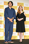 Japanese calligraphy (Kanji) artist Soun Takeda (L) and Jessica Chastain (R) pose for the cameras during a stage greeting for the film The Zookeeper's Wife on November 27, 2017, Tokyo, Japan. Chastain greeted fans during the promotional event for the movie which will be released in Japan on December 15. (Photo by Rodrigo Reyes Marin/AFLO)