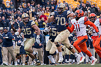 Pitt offensive tackle Brian O'Neill (70) blocks way down field for running back Maurice Ffrench as Ffrench scores on a 77-yard touchdown run. The Pitt Panthers defeated the Syracuse Orange 76-61 at Heinz Field in Pittsburgh, Pennsylvania on November 26, 2016.