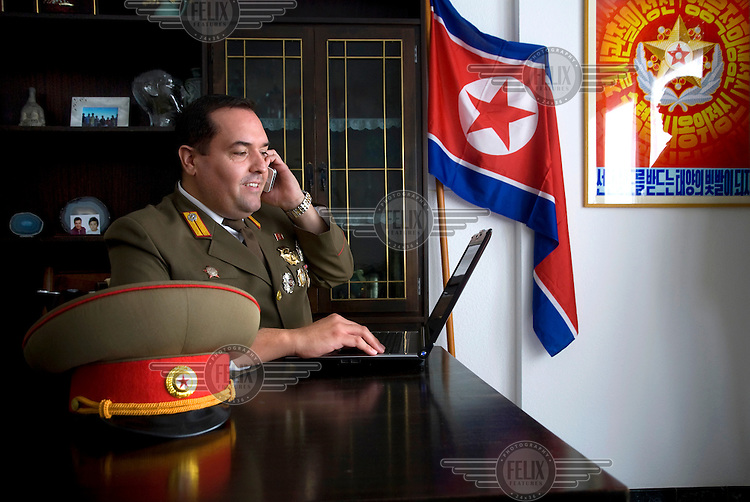 A portrait of Alejandro Cao de Benos, photographed in the village of Salomo in northeast Spain talking on a mobile phone. As a Korean-Spanish communist, Alejandro is the president of the Korean Friendship Association (KFA) and has been an advocate of the Democratic People's Republic of Korea (North Korea) since 1990. His Korean name is Zo Sun-il (Korea is One) and he works as an honorary Special Delegate of the DPRK's Committee for Cultural Relations with Foreign Countries - a North Korean government spokesman in Europe.