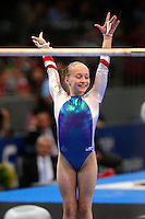 Sept 8, 2007; Stuttgart, Germany;  Ksenia Semenova of Russia celebrates finish on uneven bars on way to winning gold in the event final in women's artistic at 2007 World Championships. Photo by Tom Theobald. Copyright 2007 by Tom Theobald