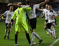 Queens players celebrate the win in the Rangers v Queen of the South Quarter Final match in the Ramsdens Cup played at Ibrox Stadium, Glasgow on 18.9.12.