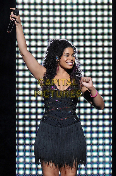 "Jordin Sparks .performs as opening act at a stop on the ""NKOTBSB TOUR 2011"" held at the Consol Energy Center, Pittsburgh, PA, USA, 15th June 2011..music live on stage in concert gig half length black dress crystals microphone tassels fringed hand arm raised up .CAP/ADM/JN.©Jason L Nelson/AdMedia/Capital Pictures."