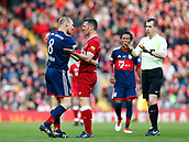 24th March 2018, Anfield, Liverpool, England; LFC Foundation Legends Charity Match 2018, Liverpool Legends versus FC Bayern Legends; Hans Pflugler of FC Bayern Legends and Luis Garcia of Liverpool Legends square up after a foul challenge by Pfluger as referee Peter Bankes loks on