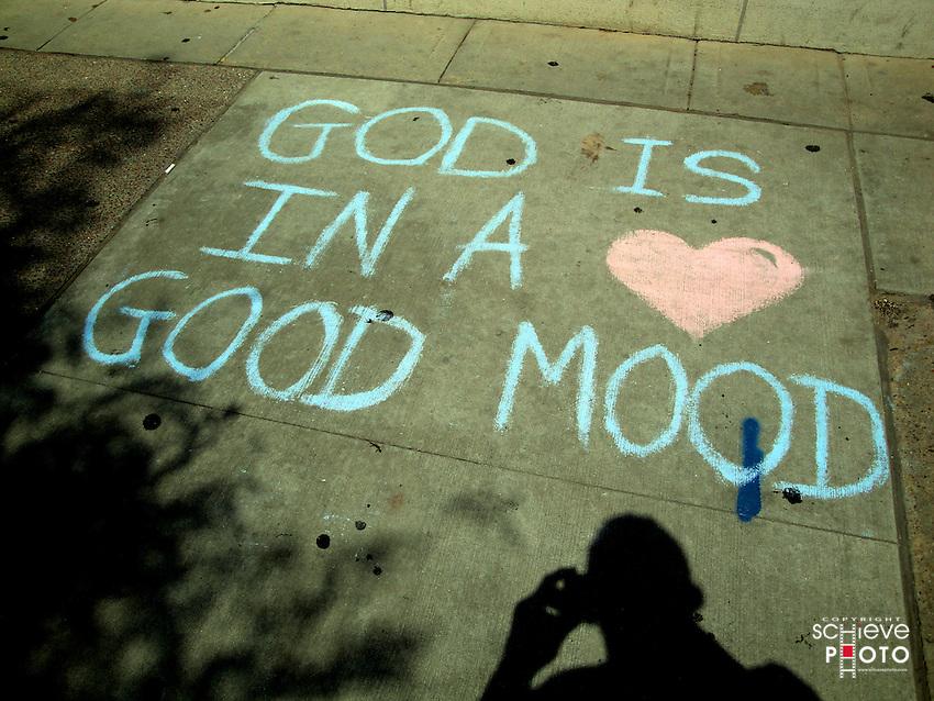 Chalk message on a Madison, Wisconsin, sidewalk.