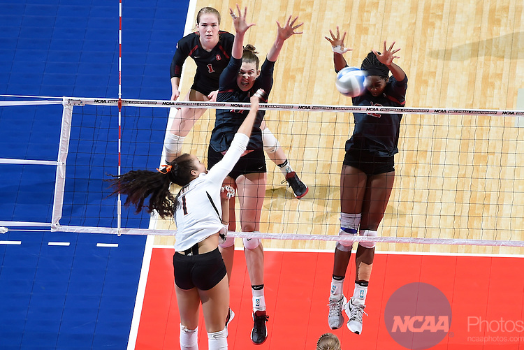 COLUMBUS, OH - DECEMBER 17:  Merete Lutz (17) and Inky Ajanaku (12) of Stanford University jump for a block against the University of Texas during the Division I Women's Volleyball Championship held at Nationwide Arena on December 17, 2016 in Columbus, Ohio.  Stanford defeated Texas 3-1 to win the national title. (Photo by Jamie Schwaberow/NCAA Photos via Getty Images)
