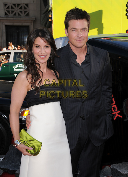 AMANDA ANKA & JASON BATEMAN .Attends The Columbia Pictures' L.A. Premiere of Hancock held at The Chinese Theatre in Hollywood, California, USA,  June 30th 2008.                                                                   .half length black and white dress suit shirt pinstriped green purse clutch bag .CAP/DVS.©Debbie VanStory/Capital Pictures