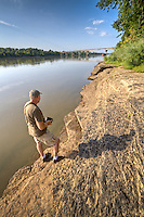 Photographer photographing The Arkansas River from Belle Point at the Fort Smith National Historic Site.