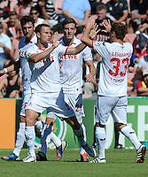 FUSSBALL  DFB POKAL        SAISON 2012/2013 SpVgg Unterchaching - 1. FC Koeln  18.08.2012 Jubel nach dem Tor zum 0:1 Thomas Broeker, Kevin Wimmer und Matthias Lehmann (v. li., 1. FC Koeln)