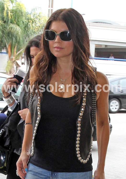 **ALL ROUND PICTURES FROM SOLARPIX.COM**.**SYNDICATION RIGHTS FOR UK, AUSTRALIA, DENMARK, PORTUGAL, S. AFRICA, SPAIN & DUBAI (U.A.E) & ASIA (EXCLUDING JAPAN) ONLY**.Stacy Ferguson aka Fergie from the Black Eyed Peas, departs From LAX Airport, Los Angeles, CA, USA. 22 July 2010..This pic: Stacy Ferguson aka Fergie..JOB REF: 11744 PHZ Candids   DATE: 22_07_2010.**MUST CREDIT SOLARPIX.COM OR DOUBLE FEE WILL BE CHARGED**.**MUST NOTIFY SOLARPIX OF ONLINE USAGE**.**CALL US ON: +34 952 811 768 or LOW RATE FROM UK 0844 617 7637**