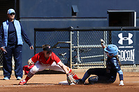 GREENSBORO, NC - FEBRUARY 22: Abby Settlemyre #29 of the University of North Carolina beats the tag by Mikayla Rubin #8 of Fairfield University at third base during a game between Fairfield and North Carolina at UNCG Softball Stadium on February 22, 2020 in Greensboro, North Carolina.
