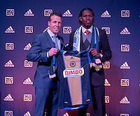 #1 overall pick Andre Blake of the Philadelphia Union  stand with head coach John Hackworth during the MLS SuperDraft at the Pennsylvania Convention Center in Philadelphia, PA, on January 16, 2014.