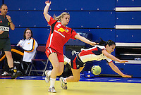 31 MAR 2010 - LONDON, GBR - Britains Holly Lam-Moores (#2 - white and blue) stumbles under a challenge from Icelands Karen Knutsdottir (#2 - red) during the teams 2010 European Womens Handball Championships qualifier (PHOTO (C) NIGEL FARROW)