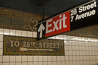 New and old signage in the  West 23rd Street subway station on the IRT line in New York on Saturday, April 28, 2012. (© Richard B. Levine)