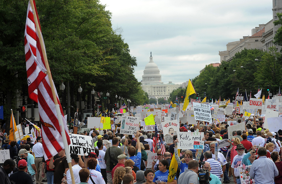A crowd marches down Pennsylvania Ave. to the U.S. Capitol to have thier voices heard during the Tea Party Protest on Sept. 12, 2009 in Washington, DC.