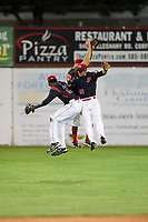 Batavia Muckdogs outfielders Thomas Jones (29), Mathew Brooks (46), and Harrison White (40) celebrate after a game against the Mahoning Valley Scrappers on August 16, 2017 at Dwyer Stadium in Batavia, New York.  Batavia defeated Mahoning Valley 10-6.  (Mike Janes/Four Seam Images)