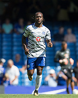 Victor Moses of Chelsea warms up ahead of the Premier League match between Chelsea and Everton at Stamford Bridge, London, England on 27 August 2017. Photo by Andy Rowland.