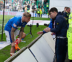 13.05.2018 Hibs v Rangers: Jason Cummings gives his boots to the fans