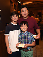 LOS ANGELES - FEBRUARY 27: In honor of Fresh Off the Boat's 100th episode cast members Hudson Yang (R), Ian Chen, Forrest Wheeler (L) celebrated with an elaborate cake-cutting and champagne toast on Stage 88 on the Fox Lot on Wednesday afternoon. (Photo by Frank Micelotta/TCFTV/PictureGroup)