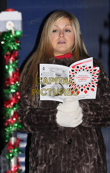 NIKKI GRAHAME .Big Brother 7's Nikki Grahame switches the Christmas Lights on in the Bedfordshire market town of Biggleswade, Bedfordshire, England, UK, December 4th 2009.xmas BB7 half length funny gloves brown fur coat mouth open .CAP/JIL.©Jill Mayhew/Capital Pictures