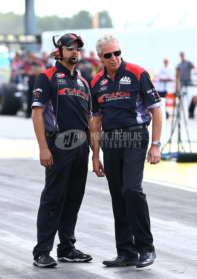 Sept. 2, 2013; Clermont, IN, USA: Crew chief Lee Beard (right) for NHRA top fuel dragster driver Steve Torrence during the US Nationals at Lucas Oil Raceway. Mandatory Credit: Mark J. Rebilas-
