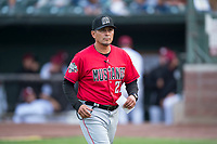 Billings Mustangs manager Ray Martinez (22) jogs off the field during a Pioneer League game against the Idaho Falls Chukars at Melaleuca Field on August 22, 2018 in Idaho Falls, Idaho. The Idaho Falls Chukars defeated the Billings Mustangs by a score of 5-3. (Zachary Lucy/Four Seam Images)