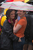 London, England. Pride in London parade. The weather ranged from bright sunshine to heavy downpours.  Photo credit: Bettina Strenske