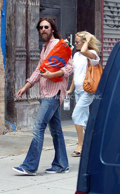 """*** EXCLUSIVE ***..Musician Chris Robinson checking mommy's very pregnant tummy. Chris and his pregnant wife Kate Hudson returning back to their New York hotel from a shopping spree. Chris was seen shopping alone at 'Other Music' store on West 4th Street and later at 'Shakespeare Bookstore' on Broadway. Later Chris teamed up with Kate and a couple of friends and they spent about an hour shopping at 'ABC Home & Carpets' prior to returning back to their hotel. Later Hudson was off to """"The Letterman Show"""" to promote her latest movie, """"Le Divorce."""" New York, August 4, 2003......Please byline: NY Photo Press.   ..*PAY-PER-USE*      ....NY Photo Press:  ..phone (646) 267-6913;   ..e-mail: info@nyphotopress.com"""