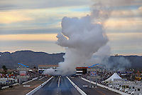 Feb 22, 2014; Chandler, AZ, USA; A pair of NHRA jet dragster drivers launch off the starting line as smoke fills the air during qualifying for the Carquest Auto Parts Nationals at Wild Horse Motorsports Park. Mandatory Credit: Mark J. Rebilas-USA TODAY Sports