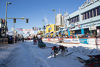 Nicolas Vanier and team leave the ceremonial start line with an Iditarider and handler at 4th Avenue and D street in downtown Anchorage, Alaska on Saturday March 4th during the 2017 Iditarod race. Photo © 2017 by Brendan Smith/SchultzPhoto.com.