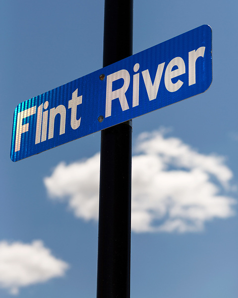 August 7, 2016. Flint, Michigan.<br />  A sign along the downtown river walk. <br />  In April 2014, the city of Flint switched its water source from the Detroit Water and Sewerage Department to using the Flint River in an effort to save money. When the switch occurred, the city failed to have corrosion control treatment in place for the new water. This brought about a leaching of lead from pipes into the water, increasing the lead content in the drinking water to levels far above legal limits. After independent sources brought this to light, the city admitted the water was unsafe and legal battles have ensued between resident and the local and state governments.