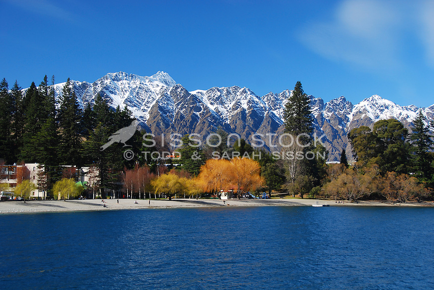 Snow covered Remarkables mountains and the waterfront at Queenstown