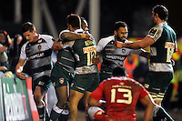 Vereniki Goneva of Leicester Tigers is congratulated by team-mates after scoring a second half try. European Rugby Champions Cup match, between Leicester Tigers and Munster Rugby on December 20, 2015 at Welford Road in Leicester, England. Photo by: Patrick Khachfe / JMP