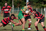 Papakura defenders try to stop the charging Kolo Vea. Counties Manukau Premier Club Rugby Game of the Week between Drury & Papakura, played at Drury Domain on Saturday Aprill 11th, 2009..Drury won 35 - 3 after leading 15 - 5 at halftime.