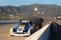 Nov 12, 2010; Pomona, CA, USA; NHRA funny car driver Tim Wilkerson explodes an engine during qualifying for the Auto Club Finals at Auto Club Raceway at Pomona. Mandatory Credit: Mark J. Rebilas-