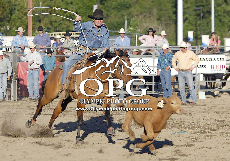 Nate Kayser from Centerville, Washington scored a 12.70 in the Calf Roping competition during the Thunderbird Benefit Pro Rodeo in Bremerton, Washington.