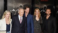 BURBANK, CA - FEBRUARY 05: (L-R) Christina Sandera, Director/producer Clint Eastwood, chainsaw wood sculptor Stacy Poitras, actors Alison Eastwood and Scott Eastwood arrive at the premiere of Warner Bros. Pictures' 'The 15:17 To Paris' at Warner Bros. Studios, SJR Theater on February 5, 2018 in Burbank, California.<br /> CAP/ROT/TM<br /> &copy;TM/ROT/Capital Pictures
