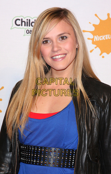 "SARAH SMITH of SAME DIFFERENCE .At the ""Spongebob Squarepants - The Sponge who could Fly"" Gala performance at the Hammersmith Apollo, London, England, .March 5th 2009.musical half length black leather  jacket blue top waist belt  red clutch bag.CAP/ROS.©Steve Ross/Capital Pictures"