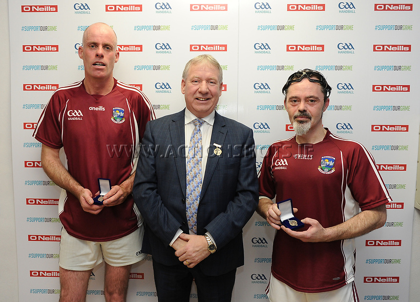 07/04/2018; GAA Handball O&rsquo;Neills 40x20 Championship Finals Silver Masters B Galway(Mairt&iacute;n &Oacute; Coistealbha/Keith Donnelan) v Tyrone (Chris Curran/Finbar Fullen); Kingscourt, Co Cavan;<br /> Runners up Mairt&iacute;n &Oacute; Coistealbha and Keith Donnelan with GAA Handball President Joe Masterson<br /> Photo Credit: actionshots.ie/Tommy Grealy