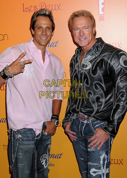 """JEFF BOZZ & DEVIN HAMAN.""""Sunset Tan"""" Season 2 Premiere Party at Les Deux, Hollywood, California, USA..July 30th, 2008.half length black white leather pattern print jacket shirt pink v peace sign.CAP/ADM/BP.©Byron Purvis/AdMedia/Capital Pictures."""