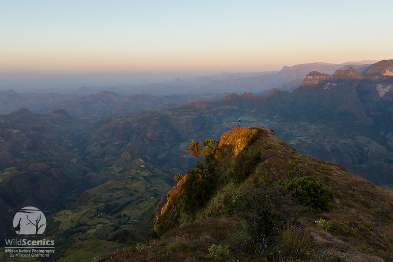 A man enjoys the sunset view from a view point in the Simien Mountains.